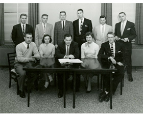 The Western Debaters with sponsor, Russell Miller, seated in the center. The young woman on the right is Elizabeth McWhorter who won the women's division at the Grand National Forensic Tournament that year, 1956.