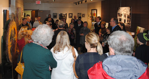 Friends and family gather in the Harry L. Jackson Gallery to commemorate the life of David Garvin.