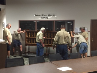 Six employees moved the DLSC manuscripts card cabinet to Gatton Academy yesterday.