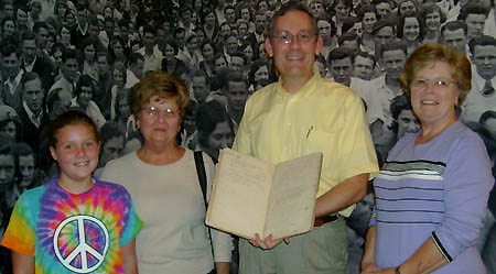 Gail Raley (right), Judy Perkins (left, with her granddaughter) and Jonathan Jeffrey, Manuscripts Coordinator, holding Miller day book
