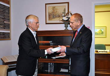 Dan Cherry, Retired Brigadier General for the United States Air Force, presented Dr. Mike Binder, Dean of WKU Libraries, with several copies of his book, My Enemy My Friend: a story of reconciliation from the Vietnam War as a donation to each of Western's six library locations.