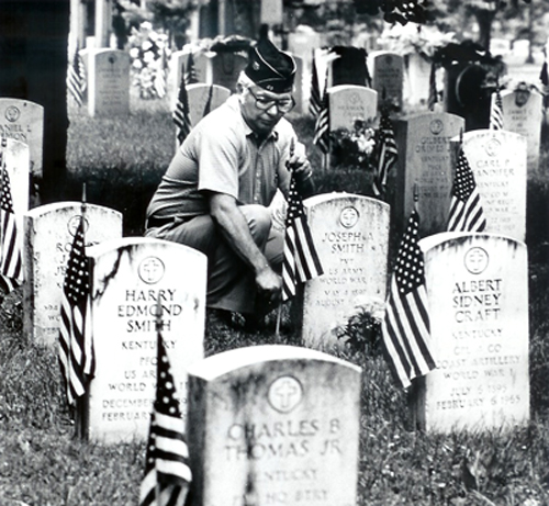 Decorating graves at Fairview Cemetery, c. 1980 (Kentucky Library)