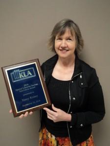 Nancy with award