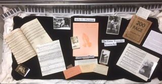 A closeup of items in Manuscripts, our Photograph Collection and our Sheet Music Collection
