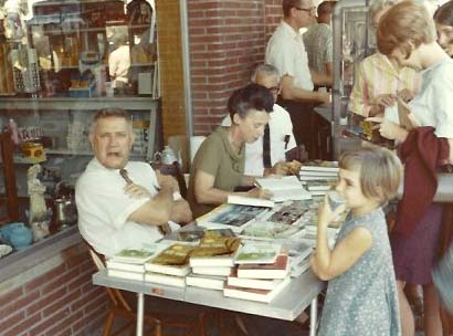 Jesse Stuart and Mary Washington Clarke at a book signing, Greenup, Ky., 1968